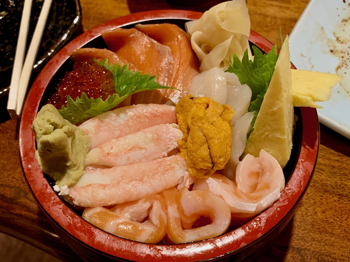 Bowl with rice and raw seafood on top