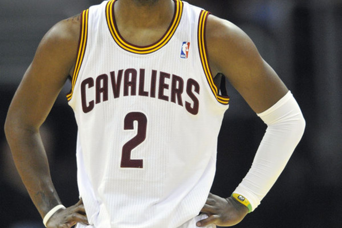 Mar 30, 2012; Cleveland, OH, USA; Cleveland Cavaliers point guard Kyrie Irving (2) glances to the scoreboard in the third quarter against the Milwaukee Bucks at Quicken Loans Arena. Mandatory Credit: David Richard-US PRESSWIRE