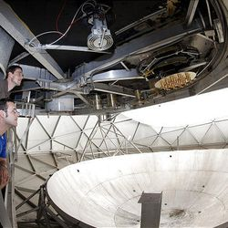 David Carter and Karl Warnick at the Puerto Rico Arecibo Radio Observatory, the largest radio telescope on Earth, installing a multi phase antenna.