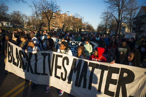 Protesters march down Plymouth Ave. N to the Minneapolis 4th Precinct on Sunday.  | Mark Vancleave/Star Tribune via AP