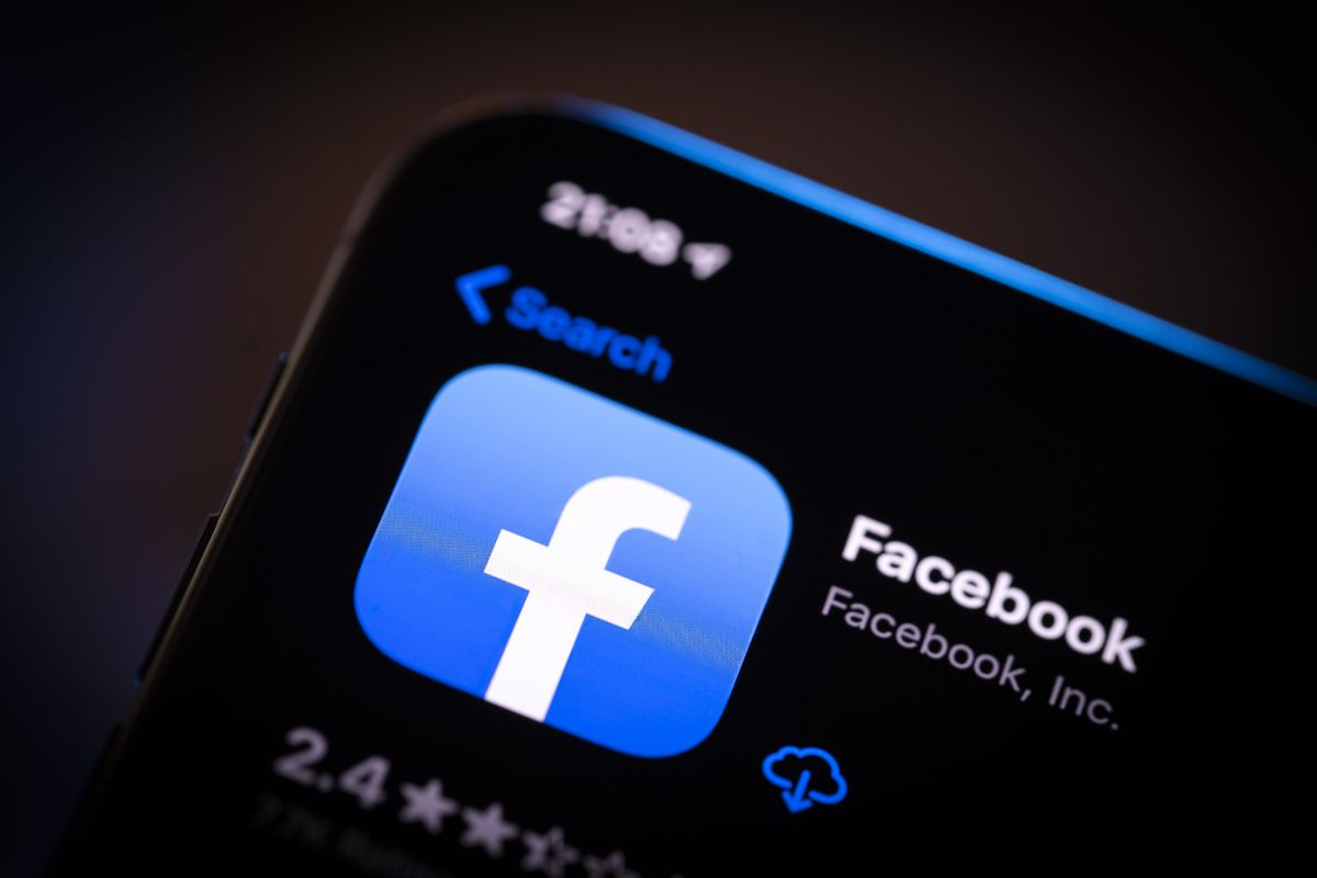 The Facebook app icon is displayed in the Apple App Store on a smartphone screen.