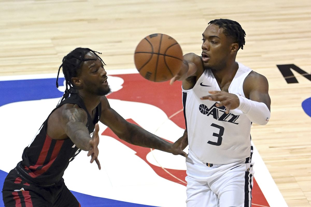 Utah Jazz guard Trent Forrest (3) passes the ball during an NBA summer league basketball game.