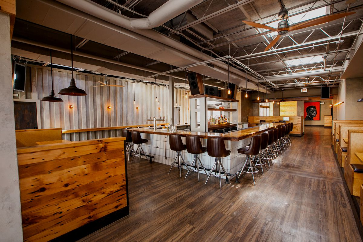 A bar space with reclaimed wood.