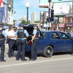 5:16 p.m. Chicago police officers meeting in the middle of Clark Street -