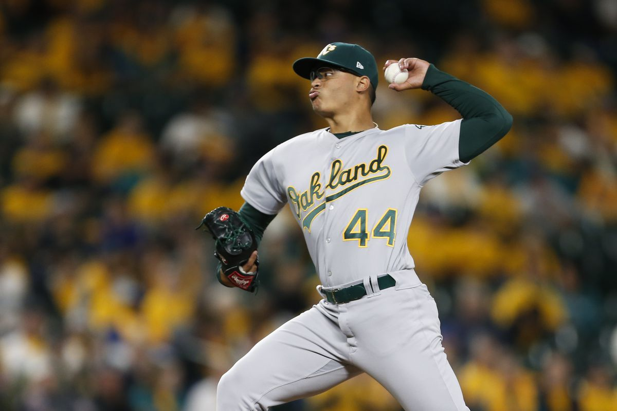 Oakland Athletics relief pitcher Jesus Luzardo throws against the Seattle Mariners during the eighth inning at T-Mobile Park.