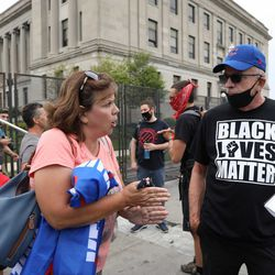 Supporters of President Trump and Black Lives Matter protesters gather outside the Kenosha County Courthouse in anticipation of the president's arrival.