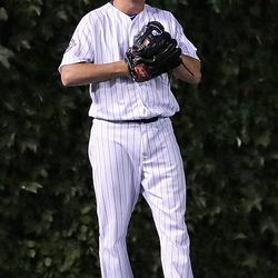 July 31: Travis Wood grins after making a catch in left field vs. the Mariners