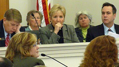 Legislators listen to revenue forecasts on Dec. 20, 2010. Chief legislative economist Natalie Mullis is seen in profile at lower left.