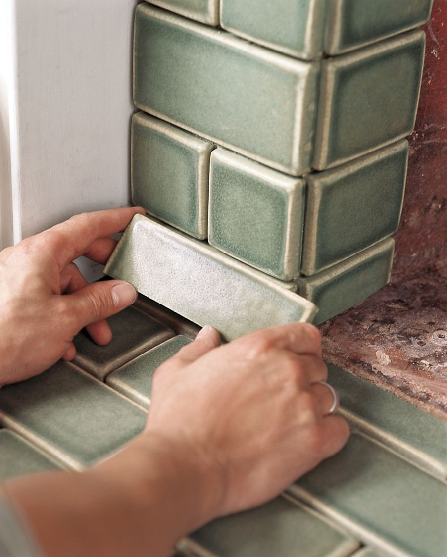 Man Sets Cut Tiles To Fireplace