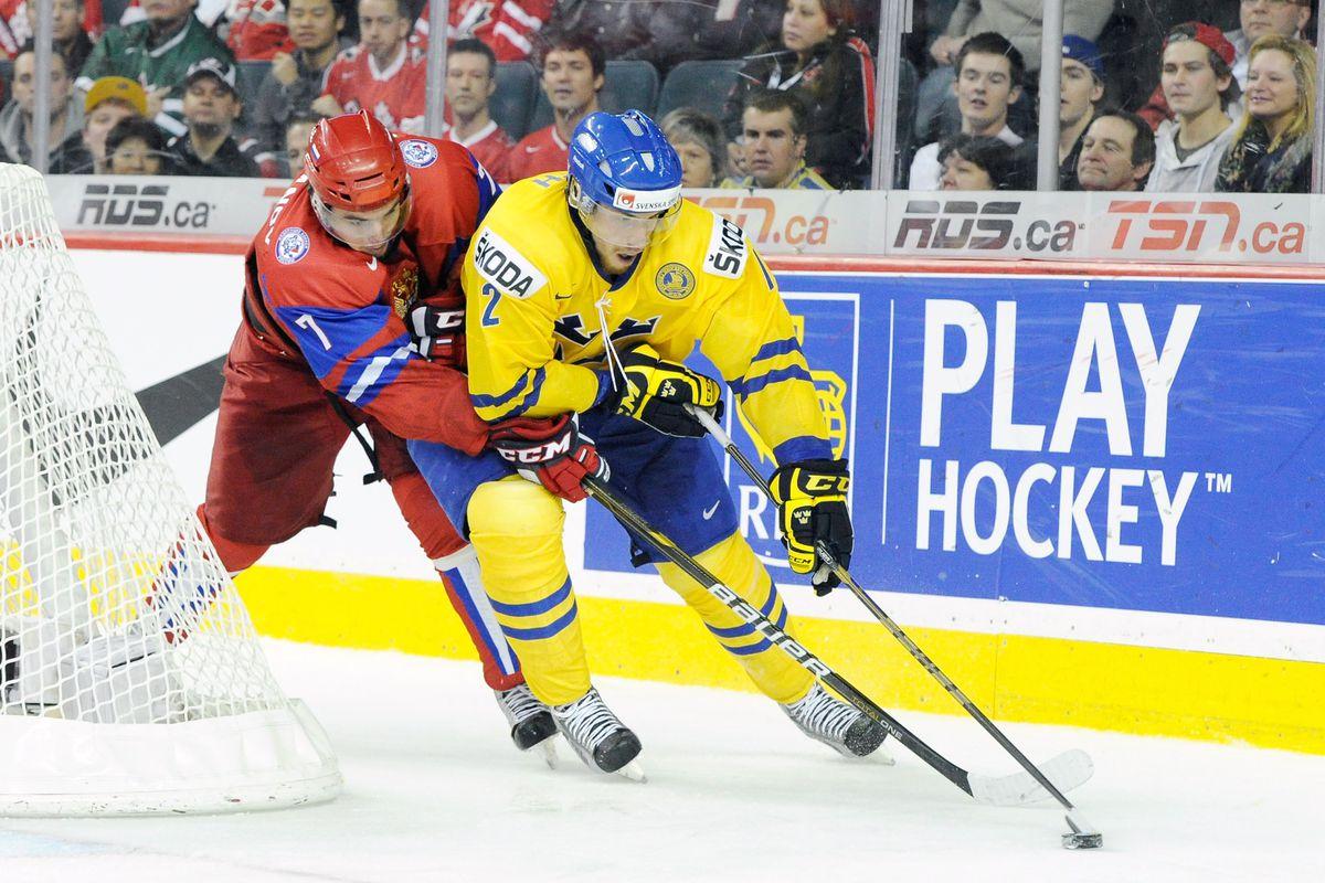 Igor Ozhiganov in red.