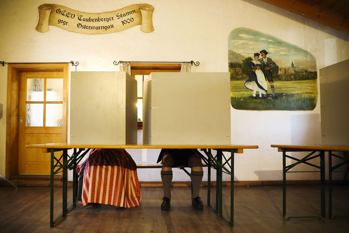 October 14: Voters wearing traditional Bavarian lederhosen and dirndls cast their ballots in Bavarian state elections in Osterwarngau, Germany. (Alexandra Beier/Getty Images)