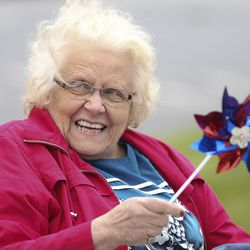 Highland Glen Assisted Living resident Joyce Terry smiles as the Highland City Youth Council, city officials, police officers and firefighters participate in a drive-by parade for the residents of Highland Glen Assisted Living in Highland on Wednesday, May 13, 2020 to show love and support for them.