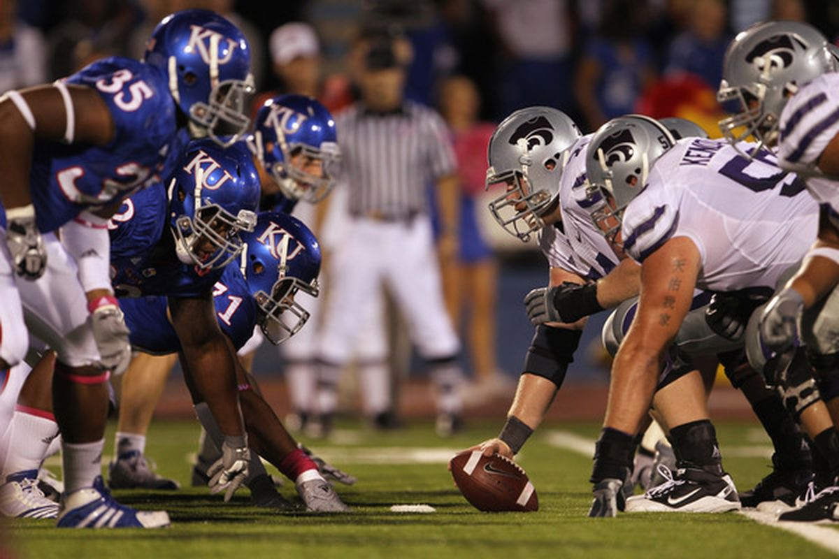 LAWRENCE KS - OCTOBER 14: Center Wade Weibert #74 and the Kansas State Wildcats face off against the Kansas Jayhawks during the game on October 14 2010 at Memorial Stadium in Lawrence Kansas.  (Photo by Jamie Squire/Getty Images)