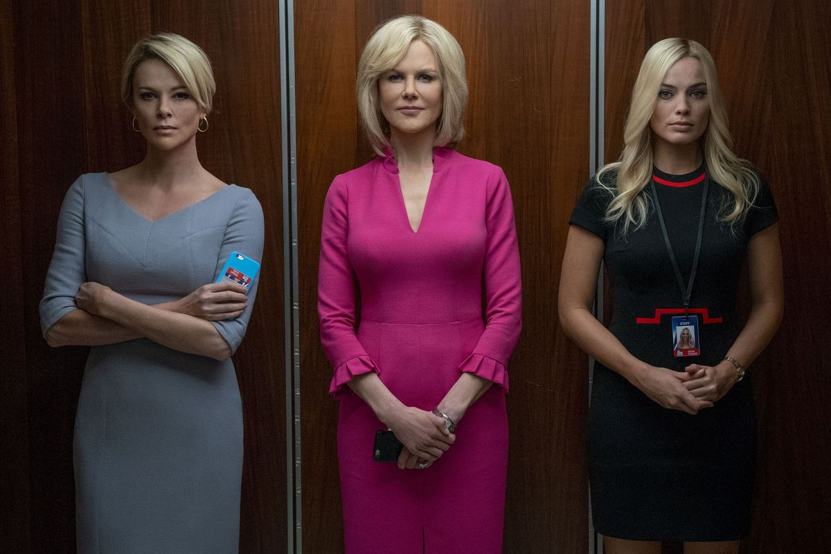 Theron as Megyn Kelly, Kidman as Gretchen Carlson, and Robbie as Kayla Pospisil all stand in an elevator,