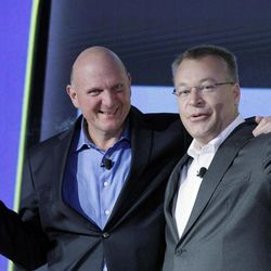 Steve Ballmer, left, Chairman and CEO of Microsoft, and Stephen Elop, President and CEO of Nokia, introduce Nokia's newest smartphone, the Lumia 920, equipped with Microsoft's Windows Phone 8, Wednesday, Sept. 5, 2012 in New York.  Nokia revealed its first smartphones to run the next version of Windows, a big step for a company that has bet its future on an alliance with Microsoft.