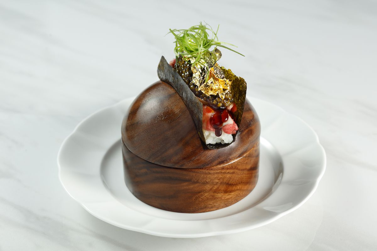 A hand roll on a wooden dome
