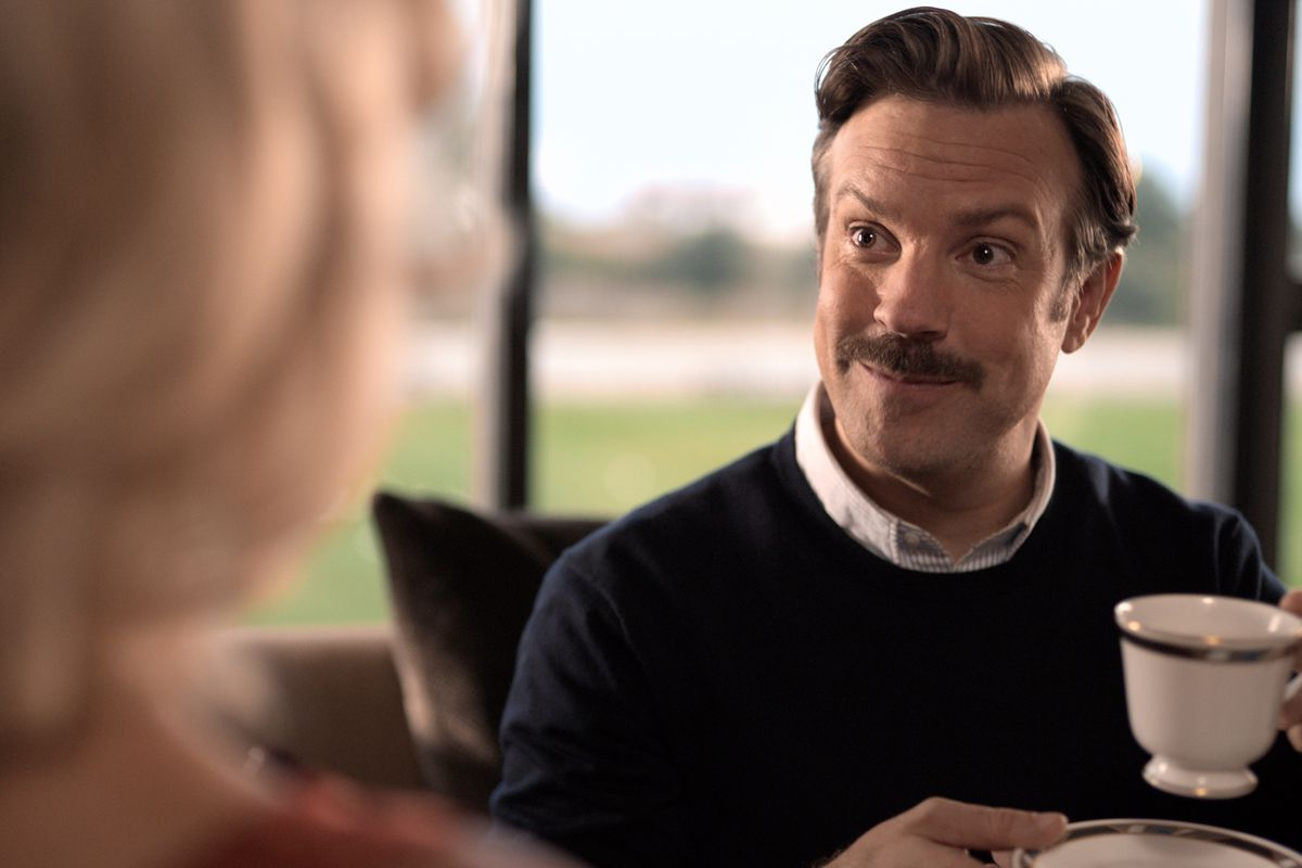 """A film still of Ted Lass (Jason Sudeikis) holding a cup of tea on the Apple TV Plus show, """"Ted Lasso."""""""