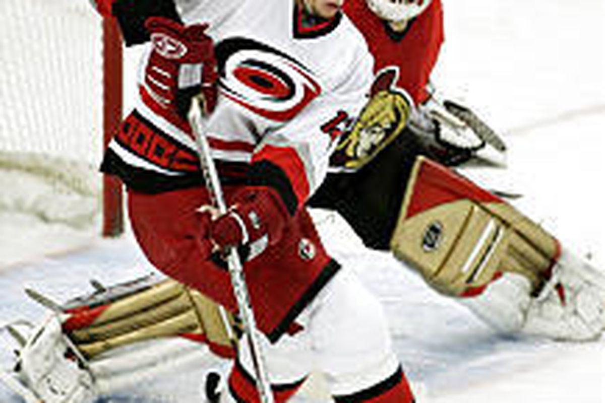 Carolina's Eric Staal tries to get a shot on Senators' goaltender Dominik Hasek in period 2.