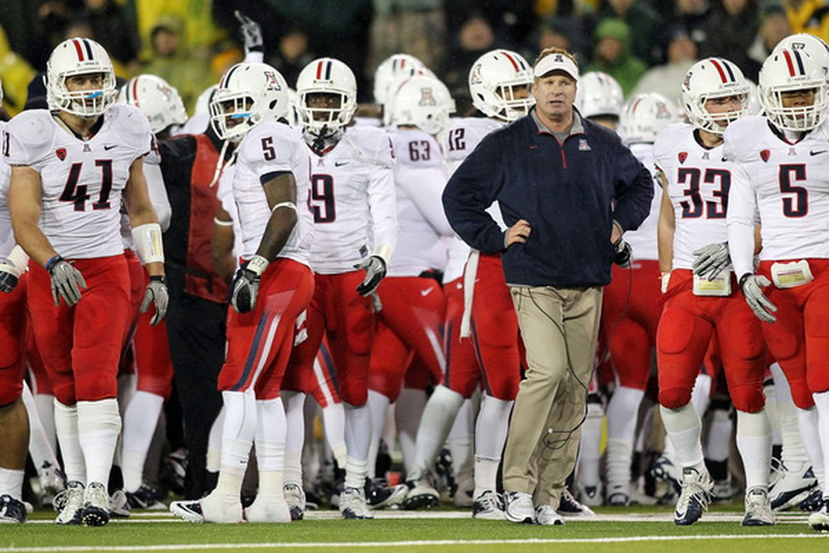 EUGENE OR - NOVEMBER 26:  Head Coach Mike Stoops of the Arizona Wildcats walks the sidelines against the Oregon Ducks on November 26 2010 at the Autzen Stadium in Eugene Oregon.  (Photo by Jonathan Ferrey/Getty Images)