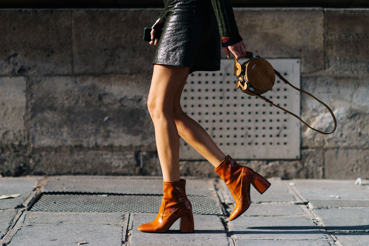 A woman in a pair of brown ankle boots