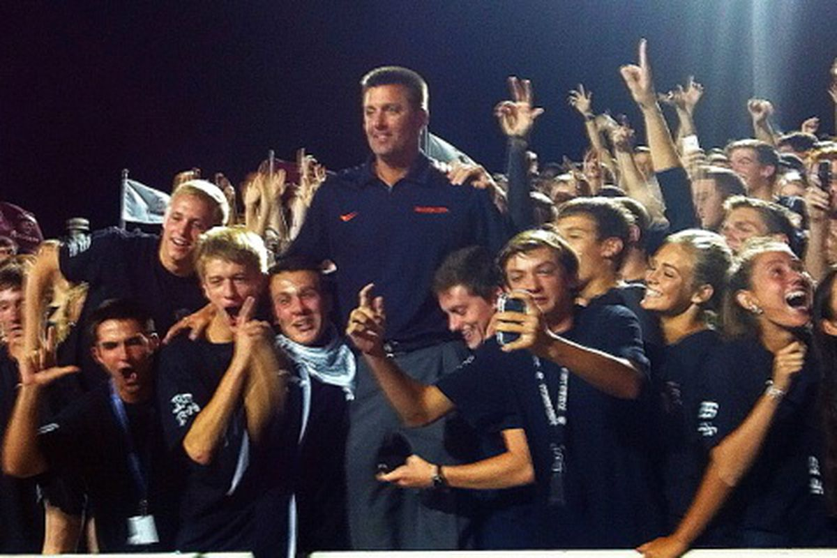 Gundy poses with fans during the game