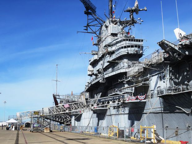 The USS Hornet in San Francisco. The aircraft carrier is grey.
