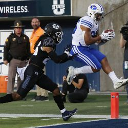 Brigham Young Cougars running back Tyler Allgeier scores on Utah State Aggies in Logan on Friday, Oct. 1, 2021.