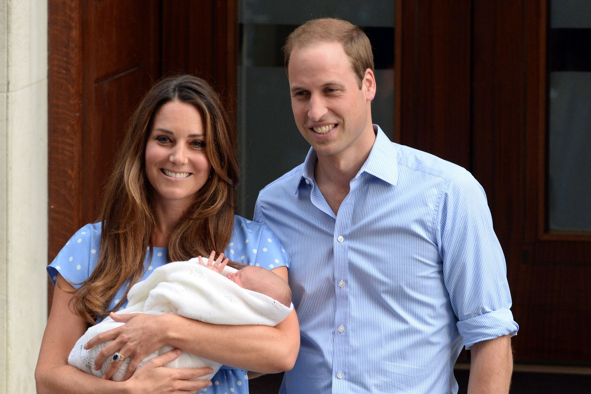 Kate Middleton and Prince William pose with their first baby George.