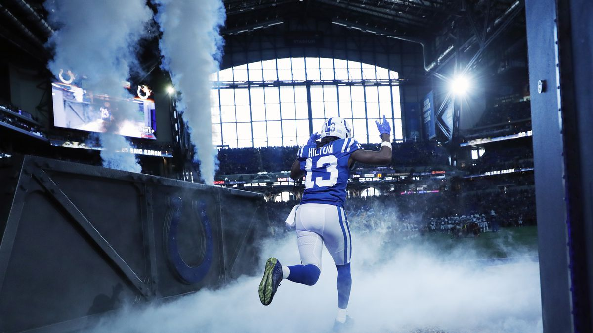 Indianapolis Colts wide receiver T.Y. Hilton runs onto the field during player introductions before the game against the Atlanta Falcons at Lucas Oil Stadium.