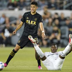 Real Salt Lake midfielder Anderson Julio, right, falls as he battles for the ball with Los Angeles FC defender Marco Farfan during the second half of a Major League Soccer match Saturday, July 17, 2021, in Los Angeles. LAFC won 2-1.