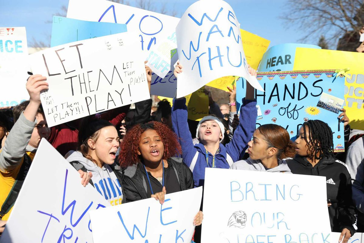 A few hundred Lincoln Park High School students protested out the school Monday over the suspension of the boy's basketball season and removal of some administrators.