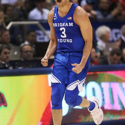 Brigham Young Cougars guard Elijah Bryant (3) yells after hitting a basket against the Utah Utes in Provo on Saturday, Dec. 16, 2017.
