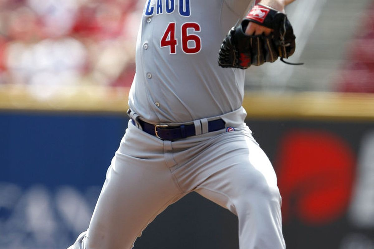 Cincinnati, OH, USA; Chicago Cubs starting pitcher Ryan Dempster pitches against the Cincinnati Reds at Great American Ballpark. Credit: Frank Victores-US PRESSWIRE