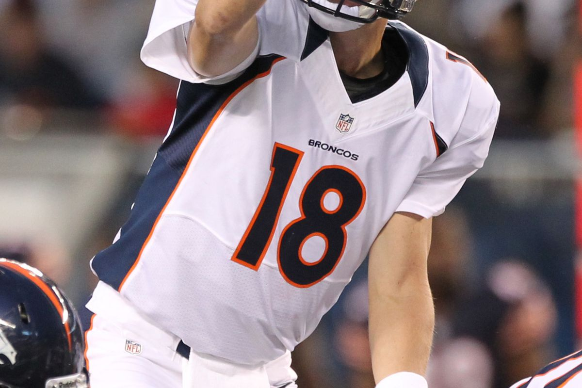Aug 9, 2012; Chicago, IL, USA; Denver Broncos quarterback Peyton Manning (18) signals against the Chicago Bears at Soldier Field.  Mandatory Credit: Matthew Emmons-US PRESSWIRE