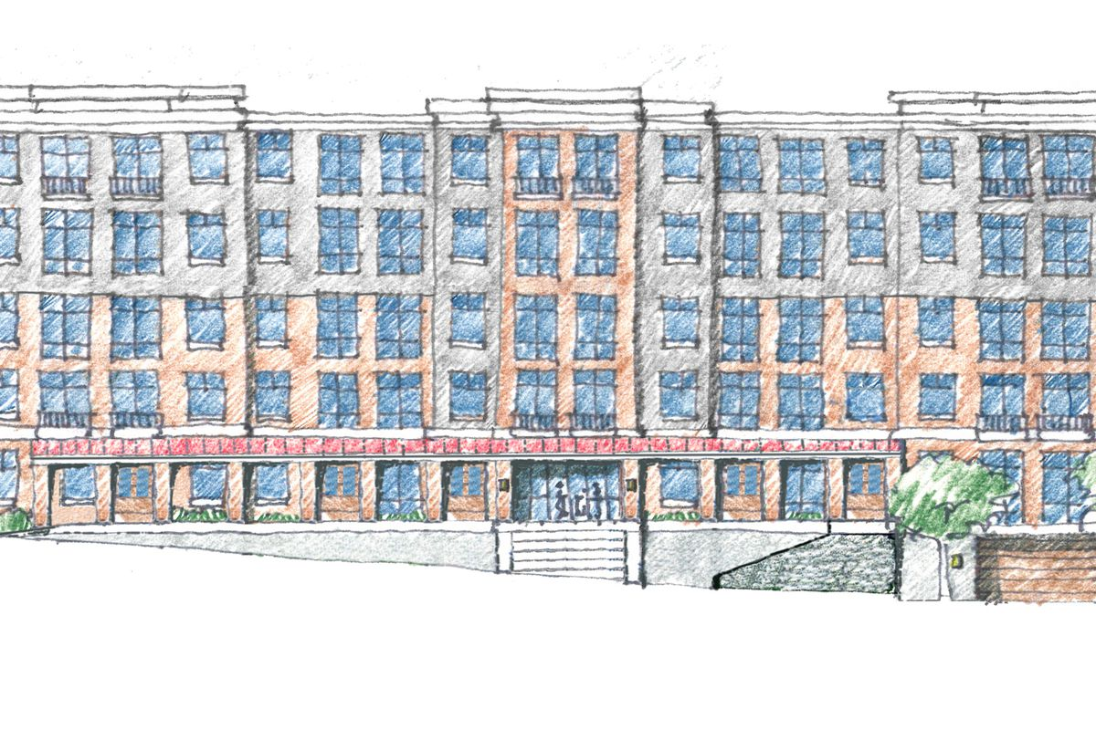 A five-story building with large windows and what appears to be brick construction in Atlanta.