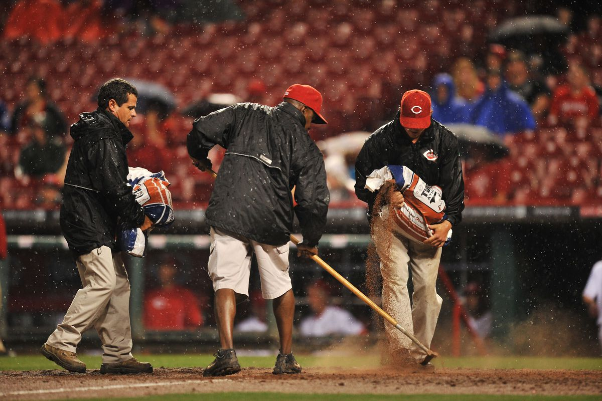 The Reds grounds crew sweeps away what's left of the Giants.