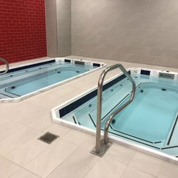NJIT's training room includes a hot and cold bath. They can fit up to 15 people each.