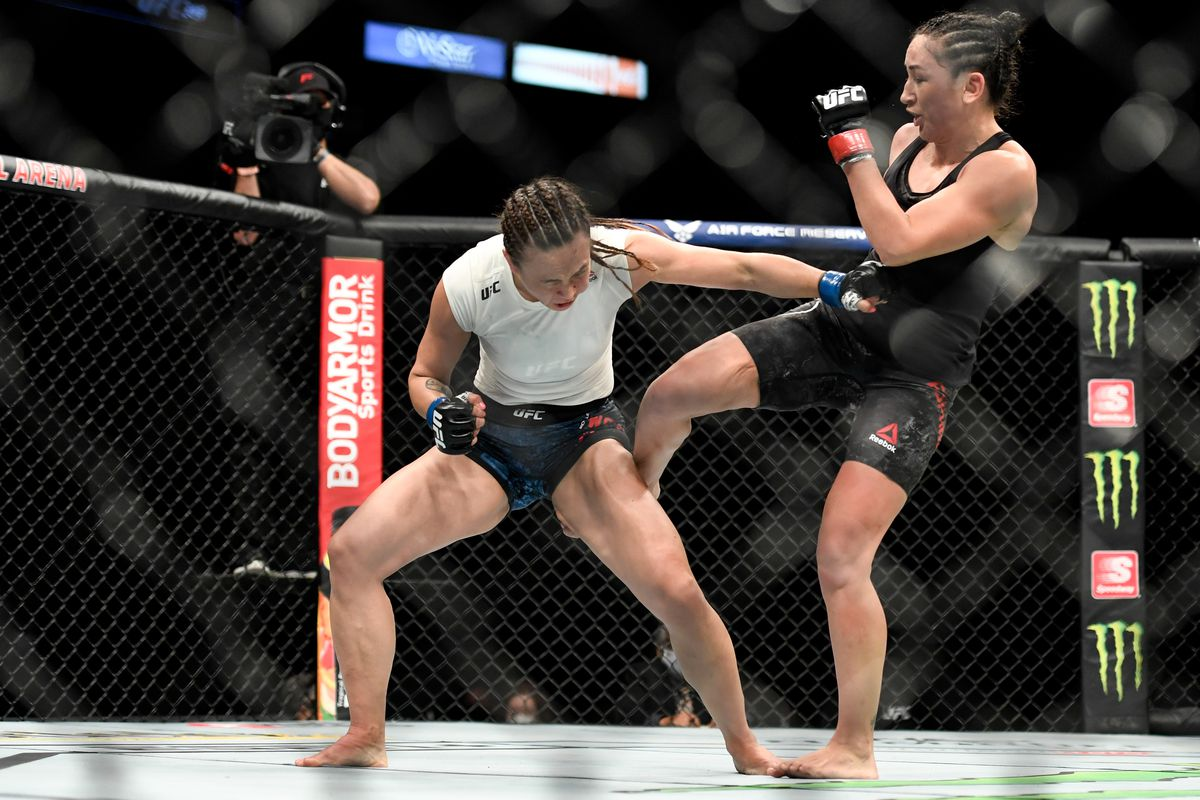 Carla Esparza of the United States kicks Michelle Waterson of the United States in the Women's strawweight fight during UFC 249 at VyStar Veterans Memorial Arena on May 9, 2020 in Jacksonville, Florida.