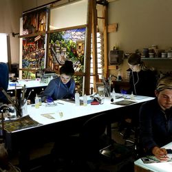 """Artists paint the details for the stained glass project called """"Roots of Knowledge"""" at Holdman Studios at Thanksgiving Point in Lehi on Friday, Sept. 16, 2016. A Guardian UK reporter called the work """"one of the most spectacular stained glass windows made in the past century."""""""