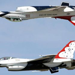 The Air Force Thunderbirds soar over Hill Air Force Base Saturday. Thousands turned out to watch the acrobatic air show and tour aircraft and exhibits at the base. The show continues today.