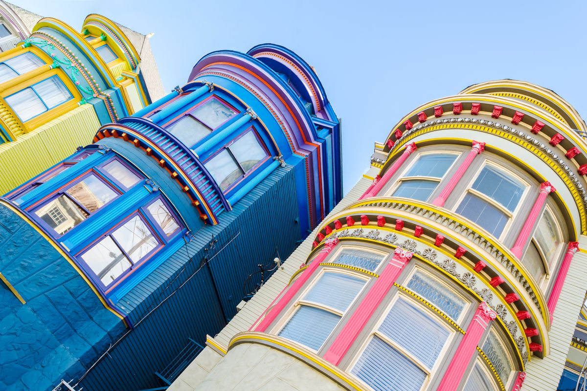 A Dutch angle shot of colorful houses in San Francisco.