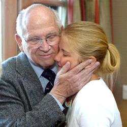 After being kidnapped for over nine months, Elizabeth Smart is reunited with her grandfather, Charles Smart, March 13, 2003.