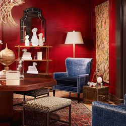 Jeannie Balsam of Jeannie Balsam LLC designed the foyer, bringing in historic artwork and decking the walls in red.