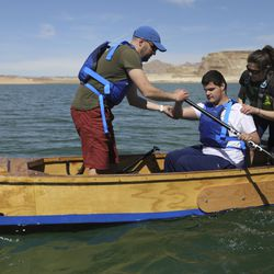 Brandon Watts, Utah Schools for the Deaf and the Blind director of outreach visions services, left, and Keri Ostergaard-Welch, teacher of the visually impaired at the school's Ogden campus, right, help Isiah Smith, center, learn efficient paddling techniques while training on Lake Powell on Friday, March 26, 2021. Smith, who is 17, was born completely blind with bilateral retinal detachment. They are part of the school's yacht club, which is training for the SEVENTY48, a 70-mile human-powered boat race from Tacoma to Port Townsend, Wash.