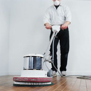 Person using a 16-in. floor polisher outfitted with 60-, 80-, 100-, and 120-grit screening.