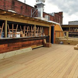The open roofdeck has two bars and will be open until 2 am. For the fall, they'll be installing a wood-burning oven up here.
