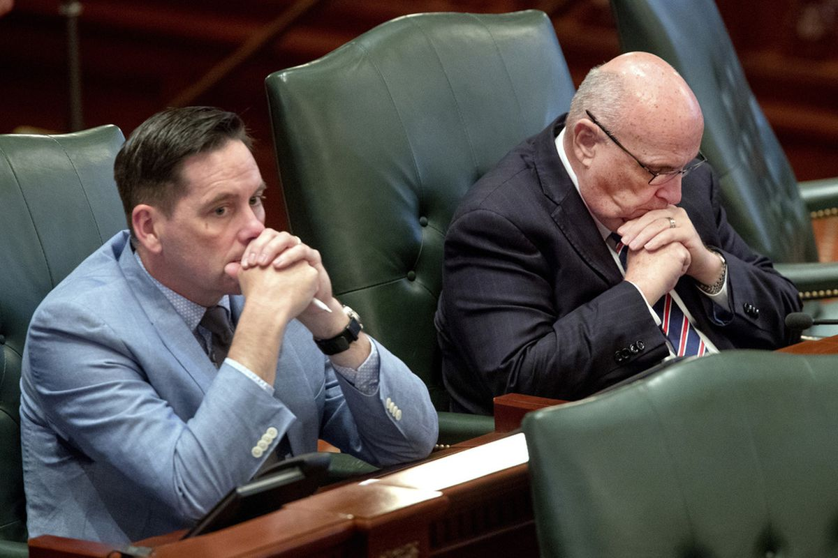 tate Rep. Mike Murphy, R-Springfield, right, bows his head as he listens to debate on the floor of the Illinois House chambers Tuesday. State Rep. Tim Butler, R-Springfield, is on the left.