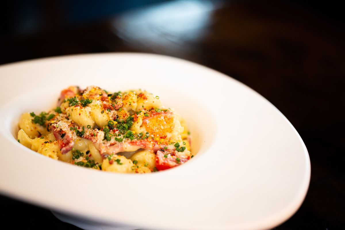 Lobster mac and cheese using knuckle and claw meat topped with chives and furkikake and bacon