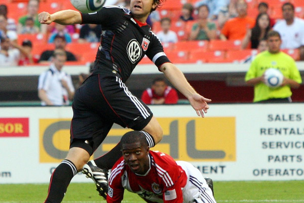WASHINGTON - MAY 29: Carey Talley #8 of D.C. United controls the ball against Michael Lahoud #11 of Chivas USA at RFK Stadium on May 29, 2010 in Washington, DC. (Photo by Ned Dishman/Getty Images)