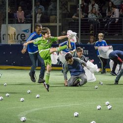 Youth soccer players then get to run around on the field to pick up the loose mini-balls... but that doesn't stop them from having some additional fun